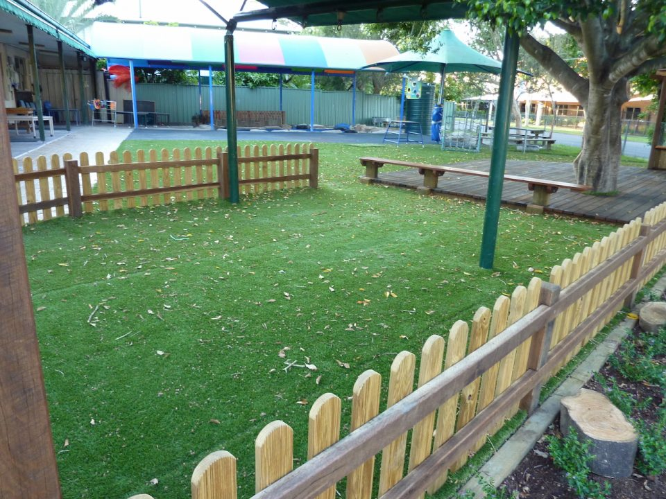 Graceville Kindy Redevelopment - Swing area complete with Rubber shock pads